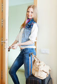 Positive woman loocking door — Stock Photo