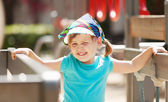 Laughing girl at playground area in sunny day — Stock Photo