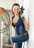 Young happy sexy woman with drill — Stock Photo