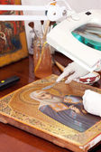 Art restorer working on the old icon — Stock Photo