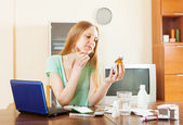 Young woman reading about medications — Foto de Stock