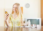 Woman with medications at table — Stock Photo