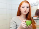 Teenager with cup of medicine gargling — Stock Photo