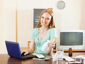 Positive long-haired woman reading about medications — Stock Photo
