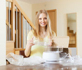 Happy blonde woman unpacking new steamer — Stock Photo