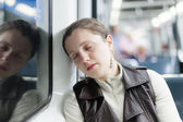 Sleeping girl sitting in train — Stock Photo
