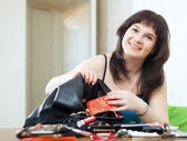 Ordinary woman can not finding anything in handbag — Stock Photo
