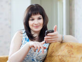 Adult woman sends SMS by mobile — Stock Photo