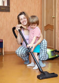 Family chores with vacuum cleaner — Stock Photo