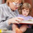 Grandmother and child reads book — Stock Photo #30994413
