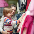 Woman and child chooses wear at shop — Foto de Stock