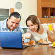 Couple looking e-mail during breakfast — Stock Photo #30994555