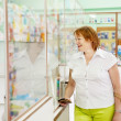 Stock Photo: Mature womin pharmacy drugstore