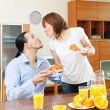 Stock Photo: Womserves breakfast her beloved man