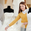 Bride chooses wedding gown — ストック写真