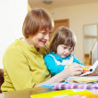 Happy grandmother and child drawing with  pencils  — Stock Photo