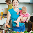 Happy family of three generations  cooking with vegetables   — Foto Stock