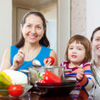 Women  with child  cooking veggie lunch — Stock Photo