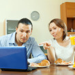 Couple looking e-mail during breakfast — Stock Photo #30995359