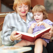 Grandmother and girl reads book — Stock Photo
