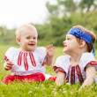 Two children in traditional folk clothes — Stock Photo