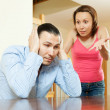 Family quarrel. Tired man listening to his angry wife — Stock Photo #30995897