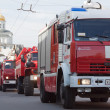 Fire trucks in carnival procession — Photo