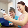 Happy couple doing shopping in internet   — Stock Photo