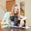 Happy young blond with new  coffee maker in home interior — Stock Photo
