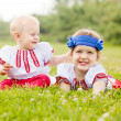 Children in folk clothes in summer — Stock Photo