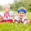 Children in folk clothes in summer — Stock Photo #30996117