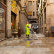 Wet cleaning of old streets  in Barcelona, Spain — Stock Photo