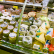 Cheese on counter in European market  — Stock Photo