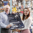 Mature man and woman holds  automotive   tool set   — Stock Photo