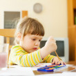 Quiet two year child painting  with watercolor  — Stock Photo