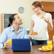 Couple looking e-mail during breakfast — Stock Photo #30996525