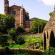 ancient church and medieval bridge in Sant Joan les Fonts — Stock Photo