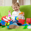 child plays with toys in home  — Stock Photo