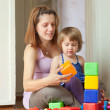 Pregnant mother plays with child — Stock Photo #30996757
