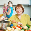Mature woman for adult daughter with baby   — Stock Photo