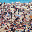 Holidaymakers sunbathe on  beach  in Barcelona — Stock Photo