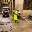 Street sweeper cleaning with water old district of city — Stock Photo