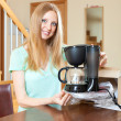 Cute young blond with new  coffee maker at the table — Stock Photo