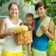 Family with harvested vegetables — Stock Photo #30996845