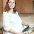 Stock Photo: Pregnant woman with salmon