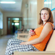 Pregnant woman waits to attendance of doctor — Stock Photo