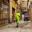 Street sweeper cleaning with water old district of european city — Stock Photo