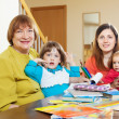 Mature woman with daughter and grandchildren — Stock Photo