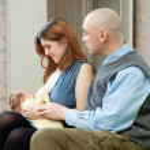 Mother breast feeding newborn — Stock Photo #30997665
