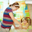Pregnant woman with child making dumplings (pelmeni) — Stockfoto